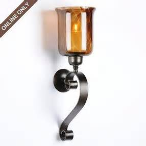 Kirklands Wall Sconces Tortoise Glass Candle Holder Wall Sconce By Kirklands Olioboard