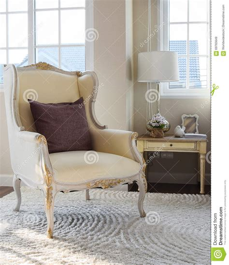 vintage bedroom chair classic chair with brown pillow on carpet in vintage