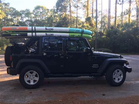 destin jeep jeep wrangler with bote padddle boards by destin jeep