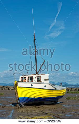 red bay boats ltd a fishing boat beached at low tide near the pier in
