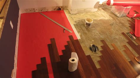 hardwood floor glue underlayment to concrete how long