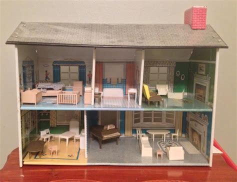 vintage metal doll houses 1950 s vintage marx litho tin metal dollhouse with furniture