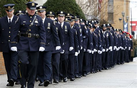 toronto officers attend funeral for slain new york