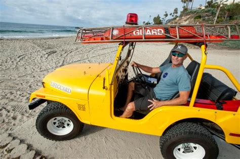 yellow jeep on beach restored 1974 lifeguard jeep is a reminder of simpler days
