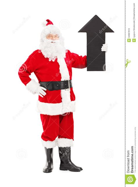 smiling santa claus holding a big arrow pointing up stock
