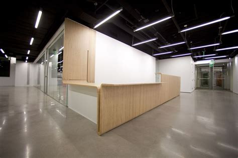 Plywood Reception Desk Reception Desk Linear Lighting Reception Waiting Areas Reception Desks