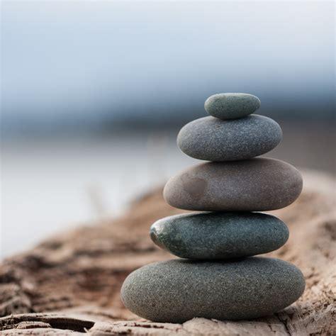 stacking beach stones balance meditation nature cairn