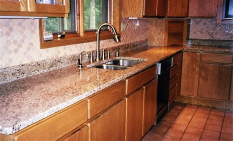 kitchen countertop backsplash features 25 years of custom cabinets