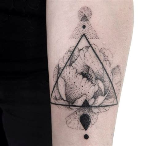 simple triangle tattoo stippling style simple forearm of flower with