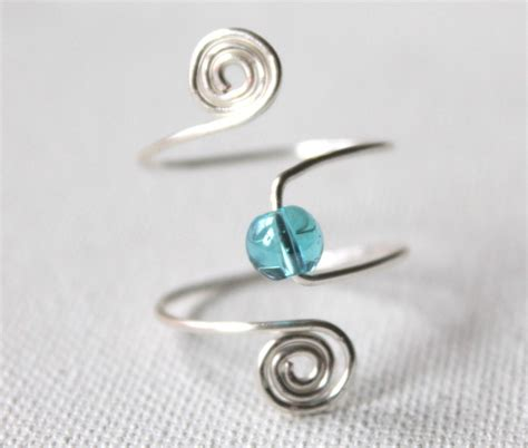 adjustable spiral and bead ring emerging creatively