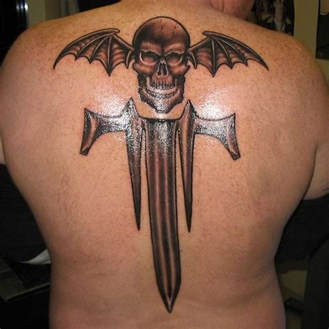 heavy metal tattoos trivium and a deathbat tattoos
