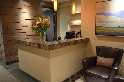 Small Reception Desk Ideas Small Office Reception Area Design Ideas With Leather Armchair And Corner Reception Desk Using