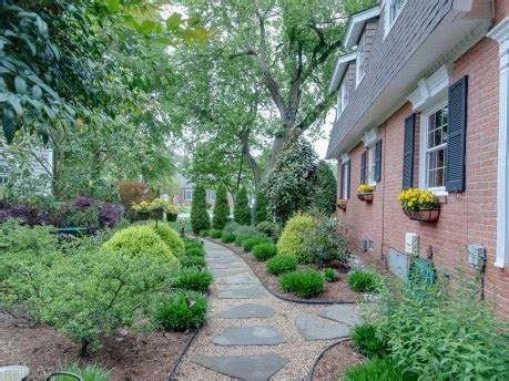 a professionally installed flat stone walkway lines the side yard inspiration for outdoors