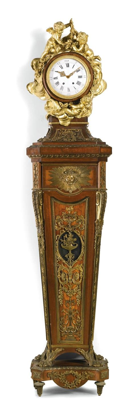 pedestal clock a louis xvi style gilt mounted and kingwood inlaid