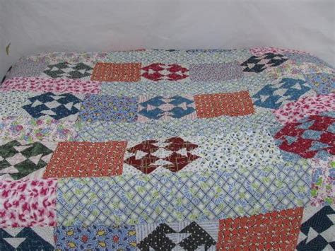 feather tick comforter old cotton prints patchwork vintage quilt feather bed