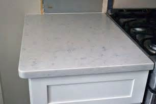 white kitchen with silestone in the color helix but as