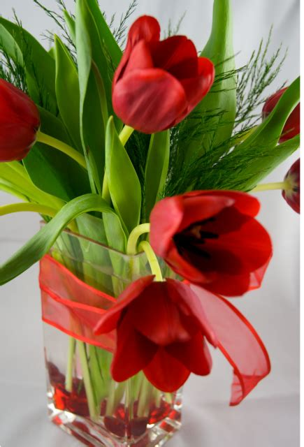 tulips or roses for valentines tulips valentines flowers in glass vase png 2