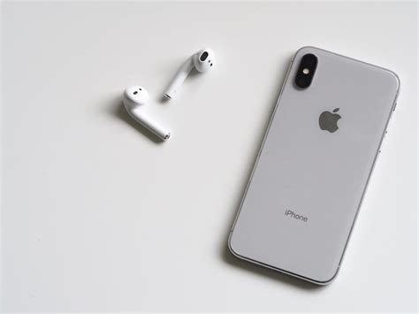 silver iphone x with airpods 183 free stock photo