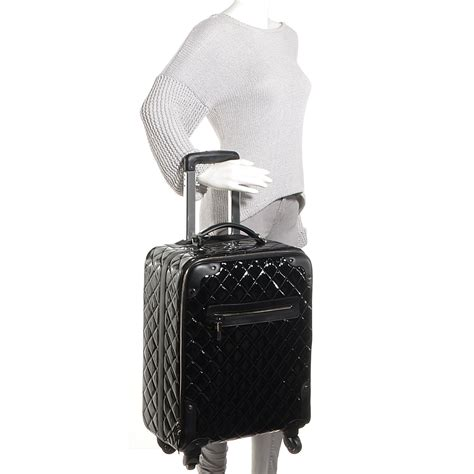 Quilted Rolling Luggage by Chanel Vinyl Calfskin Quilted Trolley Rolling Luggage Black 82321