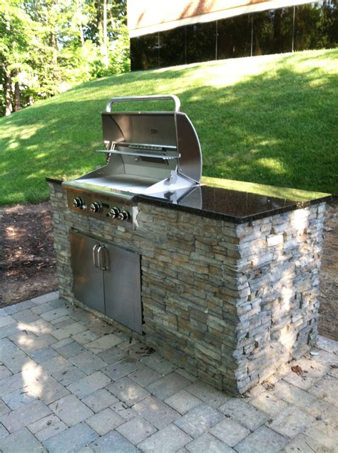 small outdoor kitchen under patio the last picture
