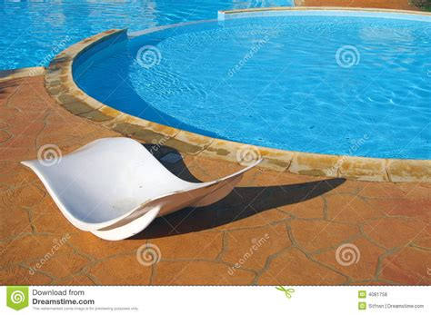 Pool Recliners by Recliners By Swimming Pool In Tropical Setting Royalty