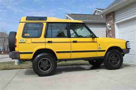 yellow land rover discovery purchase used 1997 land rover discovery xd camel trophy