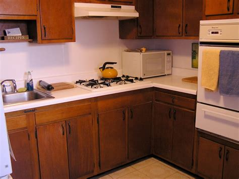 contact paper cabinets before and after the bluetrove contact paper kitchen makeover