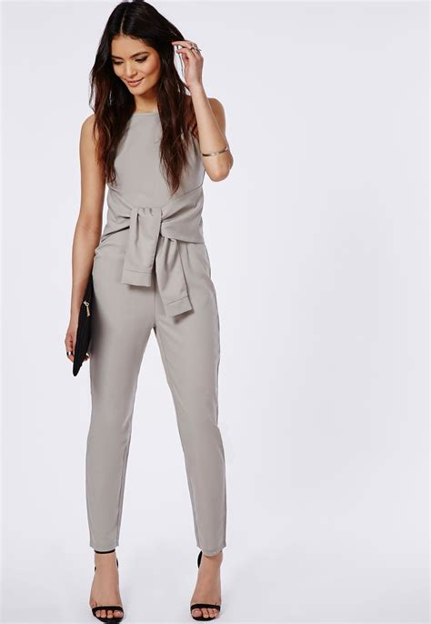 Jump Suit selena gomez shows some skin in cut out grey jumpsuit and