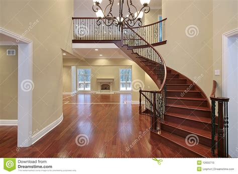 Foyer With Balcony And Curved Staircase Royalty Free Stock