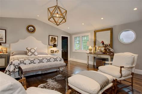 gold accent wall bedroom transitional  sitting area