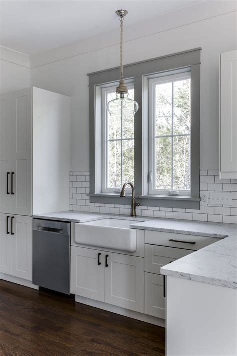 farmhouse sink ideas large cabinets and window love the white cabinets farmhouse sink and gray painted