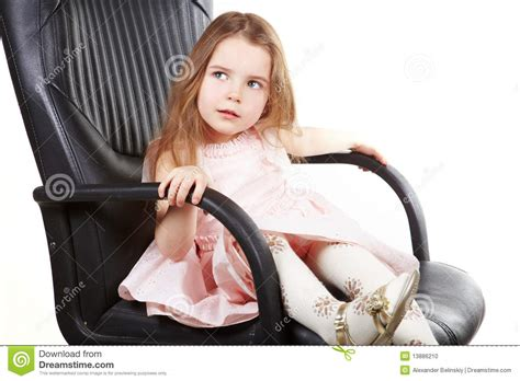 little girl on chair little girl on office chair and ask stock photo image