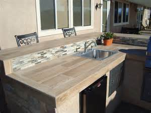 Kitchens By Design Inc outdoor gas fireplace bbqs kitchens water features