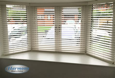 Awesome Bay Window Blinds And Curtains #2: White-wooden-blinds-bay-window.jpg