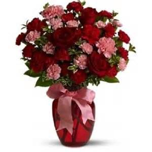 15 roses with 10 pink carnations arranged in vase