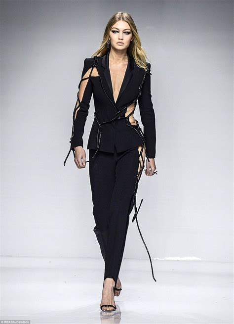 So Longdress Versace ora goes free in dress at versace show in
