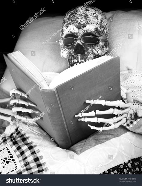 skeleton in bed skeleton reads in bed stock photo 49218319 shutterstock