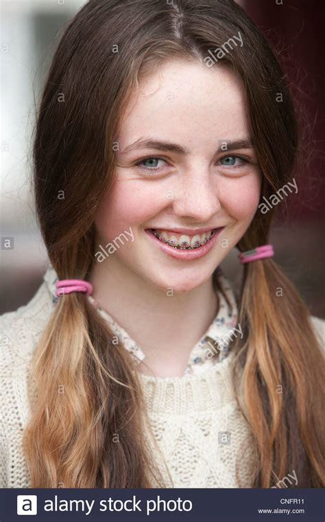 school girls braces pigtails close up portrait of smiling girl with braces and pigtails