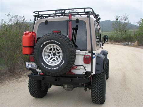 jeep swing out tire carrier garvin ats series swing away tire carrier 87 06 yj tj