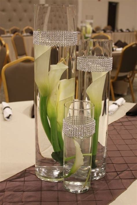 White Calla Lilies Curled Into Circular Glass Vases Make A Glass Vase Table Centerpieces