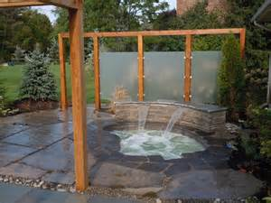 inground spa with waterfall patio and privacy screens