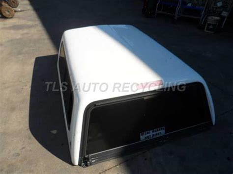 toyota tacoma pickup bed white leer camper shell