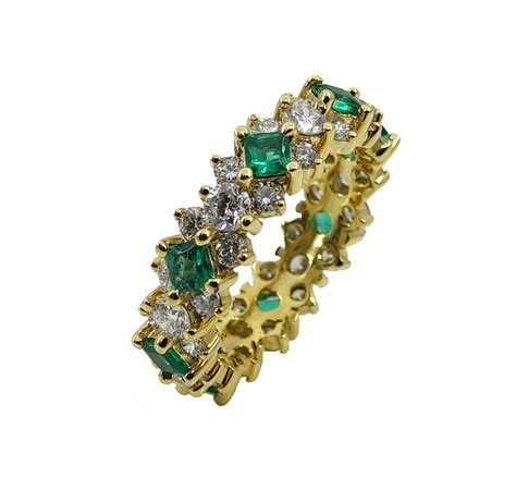 18k yellow gold and emerald eternity band world