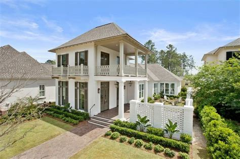 new style homes charleston style courtyard home highland homes bevolo