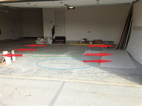 garage floor doesn t slope to drain on new construction