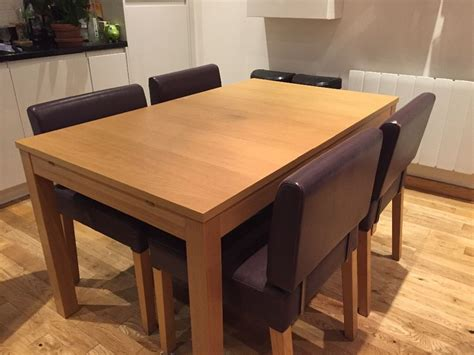 Extendable Dining Tables And Chairs Ikea Bjursta Extendable Wooden Dining Table In Oak Veneer In Brick Gumtree