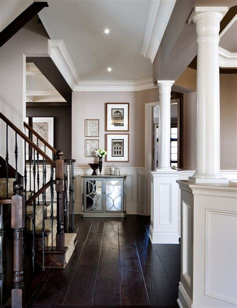 big white staircase beautiful wooden floors high dark wood floors hall transitional with dark wood flooring
