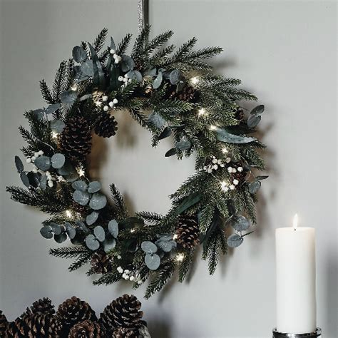 christmas wreaths bring the festive spirit to your home with a traditional or contemporary twist