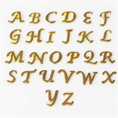 lettere corsive cursive gold letters