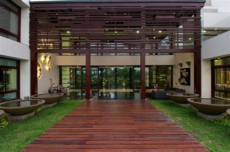 house amenities water feature wooden path contemporary house in